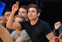 Zac Efron at the Lakers Game (5/April/14) / Zac Efron is joined by his Neighbors co-star Halston Sage attending the Los Angeles Lakers vs. Dallas Mavericks game held at the Staples Center on Friday evening (April 4) in Los Angeles.