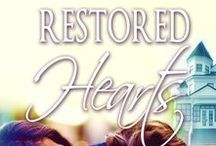 Restored Hearts / EnVee McAlister just bought a house. It's an old Victorian home that needs a lot of work, especially if she wants to get into it by Christmas.  Logan Edwards is the contractor she's hired to help her. Unfortunately, he's not like any man she's ever encountered and his arrogance and crass demeanor is making it hard to deal with him. Both she and Logan hold no punches and their terribly blunt personalities clash like oil and water.  But when she finds out about Logan's tragic past, it forces her to deal with her own insecurities and emotions she's desperately tried to forget. And instead of a house for Christmas, EnVee receives something she never expected. Available on May 5, 2016.