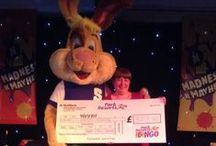 Bingo / The happy winners of our linked bingo holding there BIG cheques!