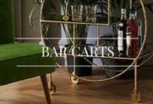 Bar Carts / Add a touch of elegance and glamour to your happy hour! Think retro decanters and fresh flowers for the perfect bar cart.