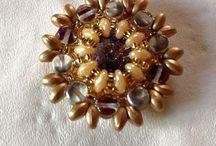 ciondoli by giannella cau jewerly / ciondoli realizzati con tecnica di tessitura ad ago con swarovski e perle cristallo di boemia