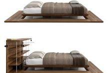 """Alcova - RNDR Studio / """"Il letto diventa luogo. E' da questa considerazione che parte l'idea del progetto Alcova. Oltre a sostenerci mentre dormiamo, il letto con l'elemento testiera ci dà il supporto per appoggiarci ma anche quello di isolarci dal resto della stanza (nel caso del letto da centro). Il calore del legno naturale viene usato come opportunità per dare una sensazione piacevole nel momento in cui ci svegliamo e per la prima volta, scalzi, appoggiamo i piedi per terra, in questo caso sul tappeto in legno."""