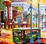 """ARTIST - Millsap, Diane / Over the past decade, Diane has painted, sketched and photographed the mysterious and beautiful city of New Orleans.  """"I have become enchanted with New Orleans because it offers and endless flow of images to paint.  This city has a depth of soul and a love of life that reaches out to everyone."""" Her style is constantly evolving, but a love of color and emotional expression is a common thread which runs through each piece."""