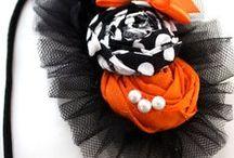 Flores de tecidos,feltros,papel,laços e afins . / by Majô Aragão