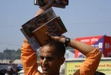 Book Distribution at Kumbh Mela 2013 on Mouni Amavasya