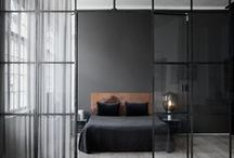 My | Bedroom style / KEYWORDS: dark, man cave | MATERIALS: wood (dark oak), leather, wool, rope | COLORS: grey, black, deep brown (wood) | DETAILS: big lamp, bed sheets to the floor (light grey linen, with patterned spread), many small and big pillows