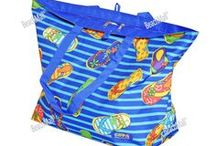 Beach Bags & Totes /  The most basic beach bag or tote has to be large enough to simply swallow all essentials, such as a beach towels, sunscreen, sunglasses, a book to read, buckets and shovels for the kids