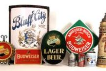 BREWERIANA / Breweriana includes any type of beer collectible related to breweries and beer. Some of the most popular types of collectibles are beer trays, corner signs, reverse-on-glass signs and tin over cardboard signs. Other Breweriana collectibles include etched glasses, tap knobs, lithograph posters, clocks, beer cans and bottles. Collectors sometimes focus on a geographical area, a particular brand, or a style of an advertising piece.