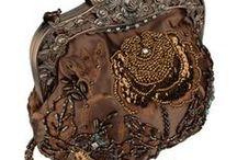 I love Vintage / We have clothing, vintage purses and other items of bygone eras.