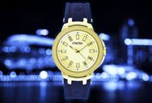 New York Watches / It's New York Time…! ΝΥ watch collection is here to Inspire you!   Oversized & impressive, New York watch collection is the icon of casual chic! Random cz stones on bezel,  baguette crystals on dial & logo engraved contemporary strap in adorable color combinations