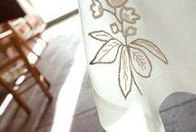 Hand embroidery for Kitchen / A little dog on a hemp tea towel or flowers on the corner of a linen tablecloth. The beauty of hand embroidery turns everyday product into unique items// Un cagnolino su uno strofinaccio in pura canapa o un fiore sull'angolo di una tovaglia in lina. La bellezza del ricamo a mano trasforma i prodotti di tutti i giorni in capi unici