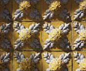 Azulejos / Azulejos are a form of painted, tin-glazed ceramic tile work. It has become a typical aspect of Portuguese culture, having been produced without interruption for five centuries. They are not only used as an ornamental art form, but also function as temperature control for homes.