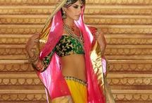 Latest Designer Lehenga's / A Lehanga cholis is the traditional attire of women in Rajasthan & Gujarat. It is the favorite apparel worn during festive seasons or special occasions like wedding & such. Traditionally, the sari & the Lehanga cholis are the most popular garments for the bride in India during the annual festival of Navratri, women throng themselves to Garba performances wearing heavily embroidered Lehanga cholis, & get a stunning Lehangas cholis from Samyakk for yourself & grace any occasion with a chic style.