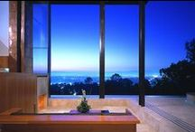 Redelco / This 4,700 sq. ft. residence lies in Studio City, California and was updated in 2005. The house now has a pavilion-like feel, with large 22-foot tall custom sliding glass doors that connect the interior and exterior. This glass allows the owners to better take advantage of the extraordinary views. An office studio is separated from the house and connected only by an exterior bridge. The project received the AIA Los Angeles Award in 2007. Project by Pugh + Scarpa Architects
