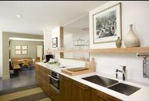 Modern Kitchen / Modern kitchen with open shelf and dining area with wall-mounted banquette seating.