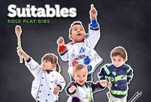 Suitables - Role Play Bibs / Imagine… Bibs kids want to wear! More than a costume, more than just a bib. Suitables are the most inspiring way to keep kids clean. At mealtime, playtime, or ANYTIME!  Continuously printed hyper-realistic design with true-to-life details encourages imaginative pretend play. Long-sleeves provide full coverage. Adjustable: No-snag velcro neck and elastic cuffs. Water/Stain-Repellent. Flip-Forward Pocket. Breathable.  Fits 1 to 3 years old Free of BPA, PVC, Lead, Phthalates, and Formaldehyde