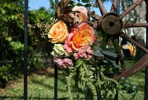 ISES Happy Hour at County Line on the Lake / rustic centerpieces with coral and ivory florals, with a Texas twist