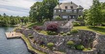 Hopewell Hall, Alexandria Bay, NY / With 10 bedrooms and more than 9 bathrooms everyone can come and enjoy everything Wellesley Island has to offer. This estate sits on 85 private acres with a 5 acre private peninsula surrounded by the St. Lawrence in which the 2 private docks reside. If you are not enjoying the St. Lawrence perhaps you can relax at the in ground pool, gardens and more. Relax outside in the expansiveness around you or come in and enjoy the multiple fireplaces, game room or beautifully updated kitchen.