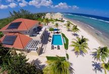 "IN HARMONY VILLA / 4 bed/4 bath luxury Oceanfront rental villa in Bodden Town, on the south shore of Grand Cayman.  It boasts an ocean front infinity pool, massive oceanfront deck, and sweeping views of the Caribbean Sean.  Bodden Town is a largely residential area and feels very much ""off the beaten track.""  You are able to experience real island culture but remain within 30 minutes of nearly every destination on the island.  For Inquiries contact Donna Anfang at 888.208.8935 or Donna.CaymanVacation@gmail.com. / by Luxury Cayman Villas"
