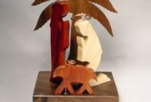 Jerry Krider / From the rural plains of Indiana, Jerry Krider of Claywood Creations creates intricate puzzle-like sculptures. Religious themes highlight a large portion of his work, including nativity wall hangings and Christmas ornaments. His work also includes whimsical pieces featuring human figures, cats, dogs, and hearts. Jerry attended the Herron School of Art and has Bachelor and Master's degrees in science from Ball State University.