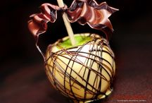 Caramel Apples / Tart Granny Smith apples dipped in caramel dipped again in chocolate. Then decorate to taste or for the occasion.