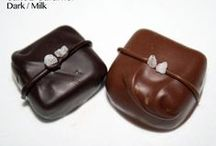 Caramels & Coconuts / Our coconut and caramel chocolates are hand-dipped in milk and dark chocolate.