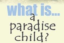 Paradise Child / Childhood is the natural state of being human. Their's is a life lived in paradise; a paradise of play and fun.