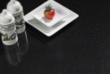 Hanex Solid Surface Dark / Hanex is a premium acrylic solid surface material offering endless design possibilities and unrivalled product performance. Whether being used in a domestic kitchen as a work surface or commercial project such as hotel, retail, healthcare or transport, the design capabilities are endless