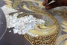 Embellishment / Embellished things. Embroidered with beads, decorative and ornamental.