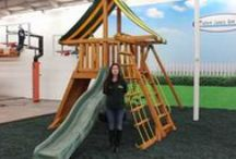 "Supremescape Swing Sets / The Supremescape Swing Set is designed to fit your yard and your budget! It is the smallest of the angled base clubhouse series, making it perfect for younger children. The Supremescape Jungle Gym features our unique ""A-Frame"" design allowing the tire swing to be installed under the clubhouse. Your kids will love swinging and spinning 360 degrees! Swing set comes complete with everything pictured."