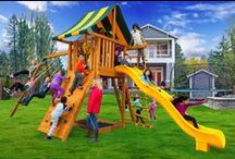 Ultimate Swing Sets / The Ultimate Swing Set is the perfect jungle gym for kids of all ages! New to the Eastern Jungle Gym line-up, this straight base swing set is a great addition to your backyard that will entertain the children as they grow. With a 6' playdeck and 12' wave slide, this swing set is ideal for medium size backyards. Your kids will love swinging from the huge 9' swing beam. Swing Set comes complete with everything pictured.
