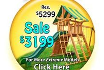 "Extreme Swing Sets / The Extreme Swing Set is the perfect jungle gym for kids of all ages! New to the Eastern Jungle Gym line-up, this angled base swing set features our unique ""A-Frame"" design and 4x6 Angle Supports allowing the tire swing to be installed under the clubhouse. Is a great addition to your backyard that will entertain the children as they grow. With a 6' playdeck, 12' wave slide and Double Ladder, this swing set is ideal for medium size backyards."