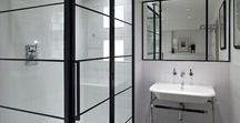 Black and grid style shower doors / A shower doesn't have to be a simple piece of glass surrounded with a metal frame - there are some more unusual styles out there and here are a few of our favourites.  #coloured #glass #shower