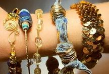 Trend: Layered Necklaces & Bracelets / Multiple strand necklaces, stacks of bracelets, layers of necklaces, elements layered together; these are all elements of fashion-forward looks for the coming year.