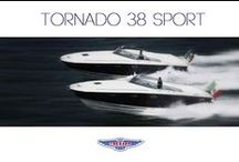Tornado 38' / Italian stream lined and sporty motorboat. It boasts generous and comfortable spaces for sunbathing still maintaining fair spaces for those who prefer shade. Fine example of shipbuilding coming from a prestigious Italian brand. 1 master cabin, 2 beds in the dinette, 1 full separate toilet, comfortable below deck dinette with minibar, Hi-Fi stereo, TV, DVD, fixed sun cover with shaded seats, exterior shower. www.chartercostasmeralda.net
