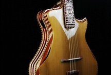 Amazing Guitars- pieces of ART to pLay WiTh / Guitars that I find, beautiful, intriguing, works of art... I would love to own! / by Marv Smith-Lebleu