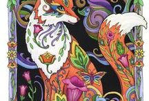 Fanciful Foxes / Foxes can't be our pets but they are strikingly beautiful. In this coloring book I depicted beautifully adorned foxes as portraits and prowlers, and as mandalas and musicians. There are fox families in fantasy settings surrounded by vines, flowers, and other wee animals.