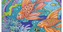 """Fanciful Sea Life / In creating """"Fanciful Sea Life"""" I immersed myself in an undersea world of wonder and imagination. The collection of 4 color images and 31 line drawings illustrate a variety of stylized ocean themes —  overflowing sunken treasure, underwater castle, and such sea dwellers as jellyfish, octopus, sea turtles, striped angelfish, whales, sea otters, walruses, seals, and more. It's designed to be a timeless treasure for colorists for you to enjoy."""