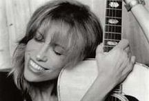 """♪ Carly Simon ♪ / Carly Elisabeth Simon (born June 25, 1945) is an American singer-songwriter. She first rose to fame in the 1970s with a string of hit records; her 13 Top 40 U.S. hits include """"Anticipation"""" (No. 13), """"You Belong To Me"""" (No. 6), """"Coming Around Again"""" (No. 18), and her four Gold certified singles """"Jesse"""" (No. 11), """"Mockingbird"""" (No. 5), a duet with James Taylor, """"You're So Vain"""" (No. 1), and """"Nobody Does It Better"""" (No. 2) from the 1977 James Bond film, The Spy Who Loved Me. / by Paul Davis"""