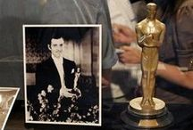 """♥ OSCAR NIGHT / The first 15 Academy Awards were presented in 1929 @ the Hollywood Roosevelt Hotel.  AMPAS member Cedric Gibbons supervised design of statuette in 1928, actor Emilio Fernandez served as model & Geo. Stanley did a clay sculpture for mold which was cast @ C.W. Shumway & Sons Foundry.  During WW II, plaster awards were later exchanged for gold. The name """"Oscar"""" is disputed, although actress Bette Davis claimed she named it. Made of gold-plated britannium the Oscar is 13.5 in. tall, weighs 8.5 lb/sr / by Sharon Richardson"""