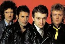 """Killer Queen / """"On drums and tiger skin trousers, Mr Roger Taylor! And on dazzling tie and bass guitar, Mr John Deacon! And on maracas and sometimes vocals, Mr Freddie Mercury!"""" -Brian May, Live Killers, 1979."""