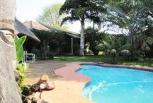 """Hluhluwe Guest House & Safaris / The Hluhluwe Guest house is Satour accredited establishment with a 3 star rating. All the bedrooms have en-suite bathroom facilities and air-conditioners & DSTV. The guest house features a swimming pool with Thatched """"lapa"""" where one can relax and unwind.   http://www.go2global.co.za/listing.php?id=2023&name=Hluhluwe+Guest+House+%26+Safaris"""