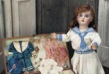 """Куклы в матросках. / """"Бабушка, посмотри какой я кораблик смастерил из дощечек!"""" - прибежав с улицы, сказал мне внук. """"Славный кораблик,дорогой мой, очень славный!- ответила я. """" А можно, Бабушка, я возьму твою куклу?  Вот эту в матроске, посажу ее на кораблик, и она поплывет . Ей очень хочется в море! Посмотри ,Бабушка, у нее глаза грустные, она наверное скучает по морю."""" / by Лара"""