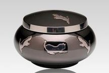 Pet Urns / Pet cremation urns are available in a huge variety to suit any family's need. Whether your beloved friend is a cat, dog, bird or even a horse, there is a perfect pet urn to capture the memories for the ages. Pet marble urns or pet metal urns are great for both indoor and outdoor settings, pet wood urns make for beautiful additions to any indoor display, and pet keepsake urns are designed to hold just a tiny portion of your pets remains so that several members of a family can share the memories.
