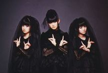"BABYMETAL / BABYMETAL is a Japanese metal idol band. Their line-up consists of Suzuka Nakamoto as ""Su-metal"", Yui Mizuno as ""Yuimetal"", and Moa Kikuchi as ""Moametal"". The concept of the group is a fusion of the heavy metal and Japanese idol genres.  Their vocals are backed by heavy metal instrumentation played by the Kami Band."