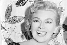 The 50's Sweater Girls / The term Sweater girl was made popular in the 1940s and 1950s to describe Hollywood actresses like Lana Turner, Jayne Mansfield, and Jane Russell, who adopted the popular fashion of wearing tight sweaters over a cone- or bullet-shaped bra that emphasized the woman's bustline