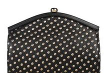 W&G Harley  / The 'Harley' is a leather curved frame clutch bag. The gold-foil dots give the body a studded effect, mirroring the round gold-plated brass clasp.