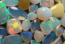 """October's Opal  / The name opal derives from the Greek Opallos, meaning """"to see a change (of color)."""" Opals range in color from milky white to black with flashes of yellow, orange, green, red, and blue. An opal's beauty is the product of contrast between its color play and its background."""