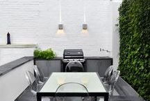 CAMDEN - Urban Roof Gardens / CAMDEN: Our clients wanted to maximise the space available on their terrace whilst also making it more child friendly. We replaced the existing skylight with walk on glass and built a slick BBQ unit at the rear of the terrace. A useful kitchen garden and sink were also incorporated into the design. The clear contemporary furniture reflects light and adds to the feeling of space. The vertical green wall adds a fantastic vibrant block of colour to the terrace.