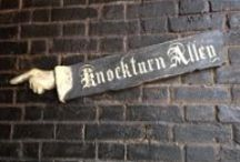 ◬ knockturn alley / Knockturn Alley is a shopping area off Diagon Alley in London. It is filled with lots of shops devoted to the Dark Arts.